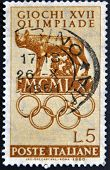 ITALY - CIRCA 1960: A stamp printed in Italy shows Capitoline Wolf and symbol of the Olympics