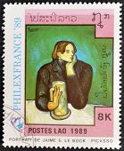 A stamp printed in the Laos shows painting