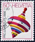 Switzerland - Circa 1986: A Stamp Printed In Switzerland Shows A Peg-top, Circa 1986