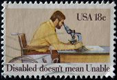 Stamp Shows Man Looking Through Microscope