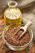stock photo of flax plant  - Linseed oil and flax seeds on a table - JPG
