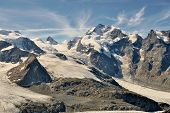 Piz Bernina And Glaciers In The Valley Seen From Diavolezza And Munt Pars. Alps In Switzerland.