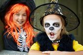 stock photo of antichrist  - Portrait of Halloween girls looking at camera - JPG