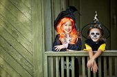 Portrait of two Halloween girls looking at camera