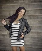 Photo of pretty young woman wearing leather jacket