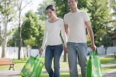 Young couple with reusable bags