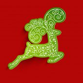 Beautiful floral decorated Christmas Reindeer on red background for Merry Christmas.