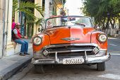 HAVANA-SEPTEMBER 10:Vintage red Chevrolet parked near El Prado street September 10,2013 in Havana.Th