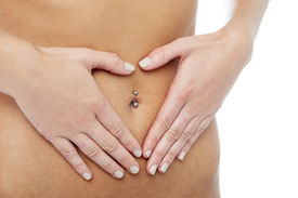 stock photo of pierced belly button  - Woman with pierced belly button white background - JPG