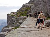 PULPIT ROCK, NORWAY - JULY 02. Tourists close to the Rock on July 02, 2010 in Lysefjorden, Norway.