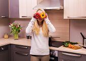 Woman in modern kitchen.