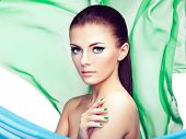 Portrait Of Young Beautiful Woman Against Flying Fabric. Beauty Woman Face