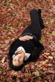 Beautiful Girl Lying In Autumn Leaves