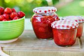 Homemade Strawberry Jam In Different Jars And Fresh Ripe Strawberries