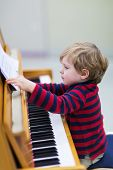 Two Years Old Toddler Boy Playing Piano