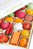 Chocolate box with vegetable and fruit