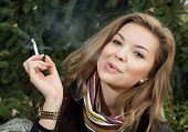 Young Caucasian Woman Smokes A Cigarette