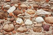 Un-structered Wall With Rocks Tiles And Cement
