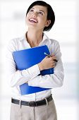 Portrait of happy smiling businesswoman with notepad or organizer