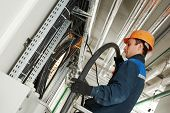 foto of fuse-box  - electrician builder engineer installing industrial cable into fuse box - JPG