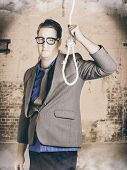 picture of gallows  - Manager business man holding noose rope at gallows - JPG