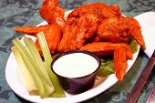 stock photo of chicken wings  - Spicy Buffalo Chicken Wings Served with Bleu Cheese and Celery