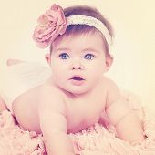 Adorable newborn baby girl with instagram effect