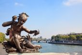 Small Child Statue Frames View Of Seine And Paris