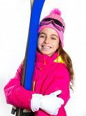 Kid girl ski with snow equipment goggles and winter wool hat