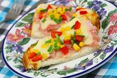 Toast with mozzarella, ham, red pepper and sweetcorn