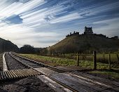 foto of unique landscape  - Unique time lapse stack landscape of medieval castle and railway tracks - JPG