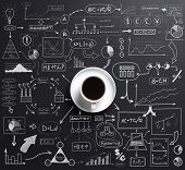 Cup of coffee over the black background with a business plan concept drawing around