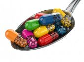 Dietary supplements. Variety pills. Vitamin capsules on the spoon. 3d