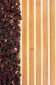 Dried Hibiscus On A Bamboo Mat