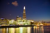 LONDON, UK - AUGUST 11, 2014: Shard of glass in night lights, view from the Tower bridge