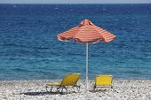 Beach In Crete With Sunbeds And The Lybian Sea