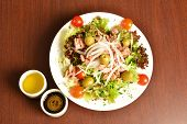 Healthy tuna salad with fresh ingredients on a table.