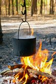 Tourist kettle over hot camp fire