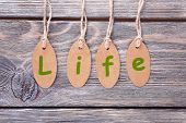 Life tags on wooden background