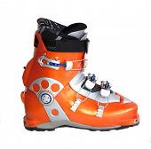 Modern orange ski boots isolated on white background