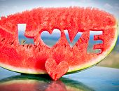 Fresh juicy watermelon slice  with love letters word on table