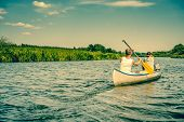 picture of canoe boat man  - Two caucasian males paddling in a canoe - JPG