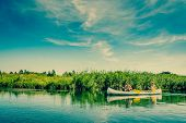 picture of canoe boat man  - Men Sailing Down The River In Beautiful Landscape - JPG