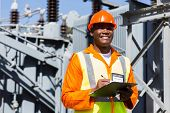 stock photo of substation  - young african technician working in electrical substation - JPG