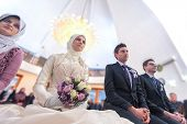 Young islamic couple marrying in mosque