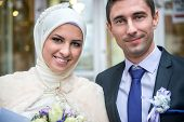 Smiling young islamic couple portrait