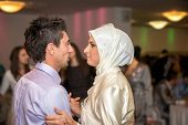 Islamic bride and groom dancing a first dance