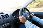 close up of woman's hands holding steering wheel