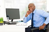 happy young african american businessman in modern office