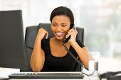 attractive african office worker talking on the phone